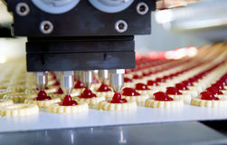 Production cookie in factory. Production cookie with cream in factory stock photos