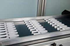 Production de couvercle de boîte en plastique de jus Photo stock