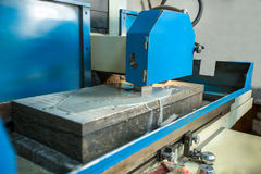 Production department. Image of grinding machine Royalty Free Stock Photography