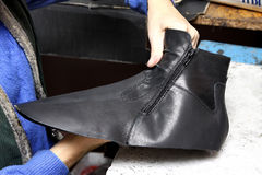 Production designer shoes.Footwear production by human hands.Sho. Production designer shoes. Footwear production by human hands. Shoe factory Stock Image