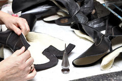 Production designer shoes.Footwear production by human hands.Sho. Production designer shoes. Footwear production by human hands. Shoe factory Stock Images