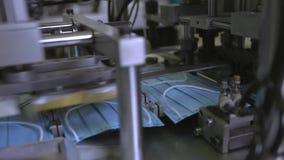 Medical mask on conveyor belt in the workshop