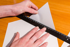 Production of an envelope. Hands for the letter Stock Images