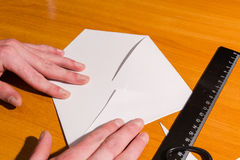 Production of an envelope. Hands for the letter Royalty Free Stock Photo