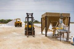 PRODUCTION OF FOOD SALT. SALT FLAT OF TRAPANI, SICILY royalty free stock photos