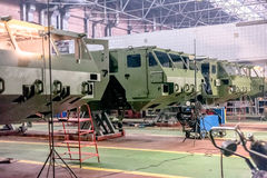 Production of fortified car bodies at factory. Production of fortified green car bodies at bright factory royalty free stock photography