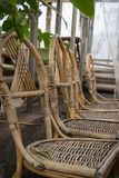 Production of furniture from the vine. Factory of creation of natural furniture. Manual production of furniture from. Wood. Wicker chair. To give Royalty Free Stock Photography