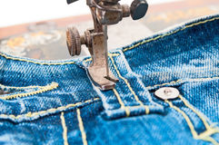 Production of garment with a sewing machine Royalty Free Stock Image