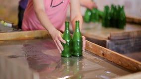 Production of glass bottles, sorting bottles after washing