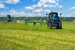 Production of grass silage. On a field Royalty Free Stock Photos