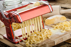 Production of homemade pasta - Italian pasta grinder Stock Photography