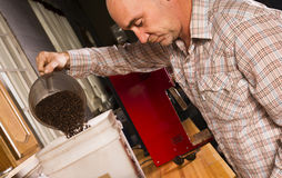 Production House Owner Weighing Roasted Coffee For Packaging Stock Photos