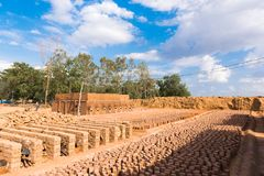 Production of indian bricks. The brick dries, Puttaparthi, Andhra Pradesh, India. Copy space for text.