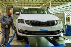 Production of Škoda Kodiaq began in Ukraine. Solomonovo, Ukraine - March 9, 2017. The mechanic checks the pressure in the tires of the Octavia car in the Stock Photos