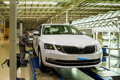 Production of Škoda Kodiaq began in Ukraine. Solomonovo, Ukraine - March 9, 2017. The mechanic checks the pressure in the tires of the Octavia car in the Stock Photography