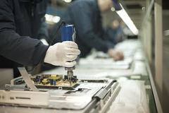 Production line. Technicians working in the factory Royalty Free Stock Images
