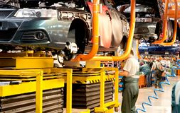 The production line for the assembly of new vehicles royalty free stock photo