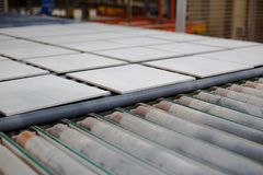 Production line with ceramic tiles royalty free stock photography