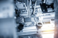 The production line of electronic board with microchip stock photo