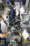 Worker using machine Stock Image