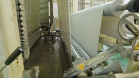 Production line, workshop or conveyor for the manufacture of lamination for fiberboard, chipboard, paper, film, plastic