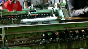 Production machines in operation stock footage