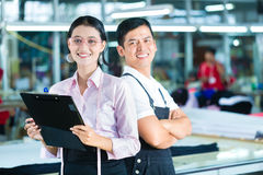 Production manager and designer in Asian factory Royalty Free Stock Image
