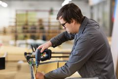 Assembler with screwdriver making furniture Stock Images