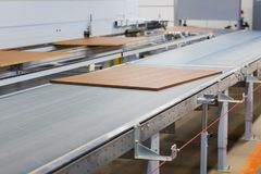 Chipboards on conveyer at furniture factory Stock Photos