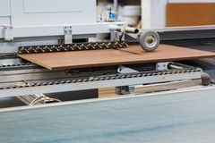 Chipboards on conveyer at furniture factory Stock Photography