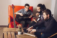 Production with musicians composing stock photos