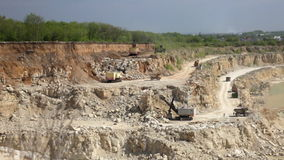 Production of a natural construction stone in an open pit stock footage