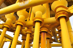 Production pipe line from well head platform to Productio. Oil and Gas Producing Slots at Offshore Platform - Oil and Gas Industry, Production pipe line from Royalty Free Stock Photo