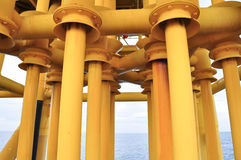 Production pipe line from well head platform to Productio. Oil and Gas Producing Slots at Offshore Platform - Oil and Gas Industry, Production pipe line from Royalty Free Stock Image