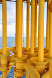Production pipe line from well head platform to Productio. Oil and Gas Producing Slots at Offshore Platform - Oil and Gas Industry, Production pipe line from Stock Photos
