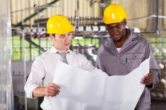 Production plan. Factory manager and worker looking at production plan Royalty Free Stock Image