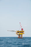 Production platform in offshore oil and gas industry. The platform with blue sky. Stock Photography