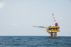 Production platform in offshore oil and gas industry. The platform with blue sky Royalty Free Stock Photos
