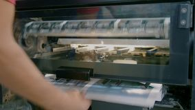 Production of printing edition in the printing house. Close up stock video footage