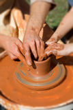 Production process on the potter's wheel Stock Photos