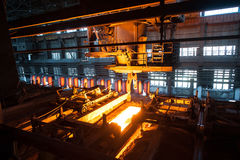 The production process in the rolling mill. Sheet of hot metal on the conveyor belt. The production process in the rolling mill Royalty Free Stock Images