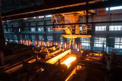 The production process in the rolling mill. Sheet of hot metal on the conveyor belt. The production process in the rolling mill Royalty Free Stock Photo