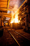 Production process in the steel mill. Pouring of liquid metal in open-hearth furnace. Production process in the steel mill Stock Photography