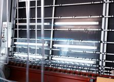 Production of PVC windows and double-glazed windows, a line for washing and drying glass for the production of insulating. Glass units stock photos