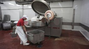 Production of sausages. Sausage Factory. Royalty Free Stock Image