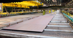 Production sheets of steel. Sheet mill in ferrous metallurgy work produces sheets of steel Royalty Free Stock Photos