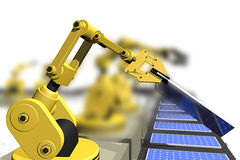 Production of solar panels with robot arms Stock Images
