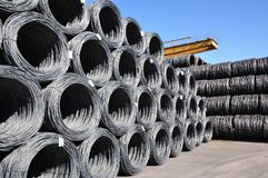 Production of steel in a steel mill - production in heavy industry - depot of steel rolls. Production of steel in a steel mill - production in heavy industry Stock Photography