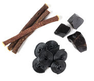Production steps of licorice, roots, pure blocks and candy. Royalty Free Stock Photography