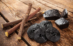 Production steps of licorice, roots, pure blocks and candy. Royalty Free Stock Image